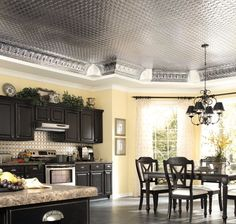 Image from http://inesblank.com/wp-content/uploads/2015/04/plain-cream-kitchen-wall-paint-color-background-contrast-with-black-interior-set-under-glossy-ceiling-tile-design.jpg.