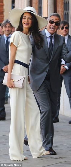 Sept 30, 2014: Her marriage in Venice to the world's most eligible bachelor, movie star George Clooney,  gave us our first glimpse of Amal's impeccable taste. For the civil ceremony she wore this bespoke cream and navy trouser suit by Stella McCartney (£1,600) with matching felt hat (£400) and 'Beckett' clutch bag (£480). Seven months on, there are online blogs dedicaterd to the human rights lawyer's chic — and staggeringly expensive — style.Total: £ 2,480