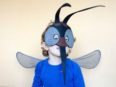 Realistic handmade Mosquito costume that includes Black Mosquito mask and Gray Wings.  The Mask is with attached elastic band and ready to wear. Made