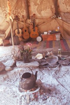 Guitars and tea makes for a boho scene.
