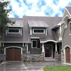 Exterior House Colors- Dark grey house with white trim, wooden looking garage door, and a dark plum door and shutters! :)