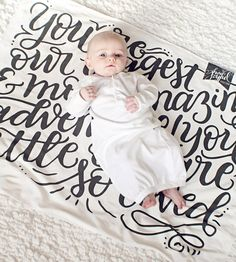 "Super soft organic knit fabric is printed with an original illustration reading, ""You are our biggest & most amazing adventure! You little one, are so loved."""