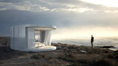 An architect and a glass door company collaborate to produce a beautiful prefabricated house with curved glass windows.