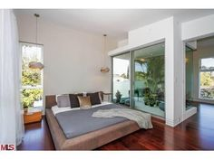Note to self:  I saw this plant room adjecent to the bed and immediately re-imagined it as a big fish tank instead.  Would that be feasible I wonder?      Reconfigurable, iPad-Controlled Proto Home in Beverly Grove - New to Market - Curbed LA