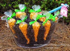 Easter garden~T~ Love this one. Clear container filled with brown shredded tissue paper. Add treat bags filled with goldfish crackers or cheddar bunnies. Could use orange jelly beans too. Maybe a mix of all three.