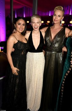 Look who we found! Michella and Salma posed with statuesque Charlize Theron, who was clad in a gold gown