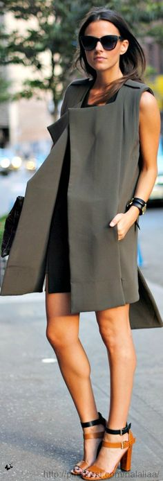 Love the look of this sleeveless coat and the two-tone strappy sandals. So effortlessly chic!