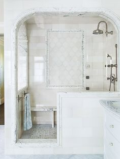 Chrome, marble ,and calming white and gray are timeless in a master bathroom. Skip a traditional shower door or curtain for a cleaner walk-in look. The curved detail on the entryway adds a touch of old-world glam. - HouseBeautiful.com