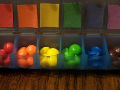 """A rainbowgram with M&M's and Skittles in a 7-day pill dispenser and a Bible verse for each day.  Give to someone who needs encouragement during a """"rainy spell."""""""