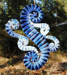 Fused Glass      Blue Waves Suncatcher  Like how the artist captured the wave with small pieces - great use of scraps!
