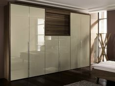 Lacquered walnut wardrobe with built-in TV La Vela II Collection by Hülsta-Werke Hüls