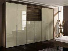 Lacquered walnut wardrobe with built-in TV La Vela II Collection by Hülsta-Werke Hüls