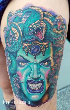 Blue Ink Medusa Girl Head Tattoo On Thigh
