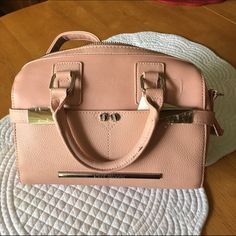 Blush mini satchel NWT NWT Steve Madden blush colored mini satchel. This purse has a removable  long strap & silver hardware with two front pockets. Steve Madden Bags Satchels