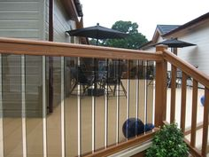 Golden Oak Deck with Cream Deckboards and Glass Pickets