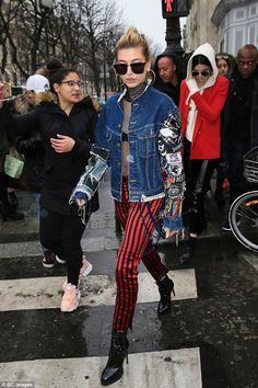 Pout of control: Hailey looked very rock 'n' roll in her striped trousers and denim jacket...