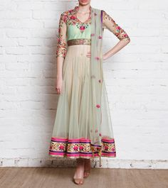 Beige & Green Embroidered Net Anarkali Suit-Kalki Beige and pista green net anarkali suit . The yoke has a lining of raw silk. The neck is embroidered with resham and swarovski stone. Dupatta is in poshlin net with resham embroidery in butti shape with kundan all over it. The pants are straight fit in raw silk.