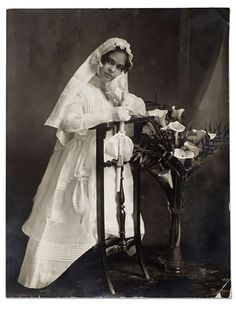 Frida Kahlo the day of her First Communion in 1920~Image via Museo Frida Kahlo