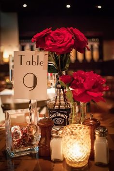 No poker chips & change the flowers...but I love the JD bottle for centerpiece...
