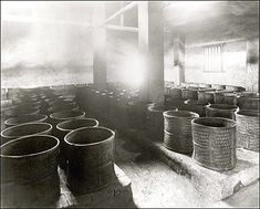 Tea leaves undergoing charcoal drying in a tea-processing firm's premises.