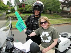 Staffer, Aimee, isn't really trying to steal this #Portland #PoliceOfficer's #motorcycle! He's just helping her show support for organ, eye, and tissue donation! Thanks #PortlandPoliceDepartment! #PPD #SundayParkways #PDX #DonateLife #OrganDonation