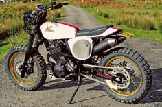 Honda Dominator. Dominators were a great bike - love this stripped back classic honda version. Great stuff