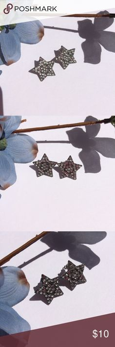 Star diamond studded earrings Star diamond studded earrings. Hard a dark silver metal background. White jewels all inside the star kind of make a flower shape in the middle. Jewelry Earrings
