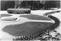 France surrendered to Nazi Germany in 1940. Adolf Hitler and his sizable ego wanted the surrender to be signed in the original rail coach that German representatives had signed surrender in over two decades earlier -- in 1918. Here, Nazi soldiers march in celebration as apart of a ceremony celebrating the surrender of France.