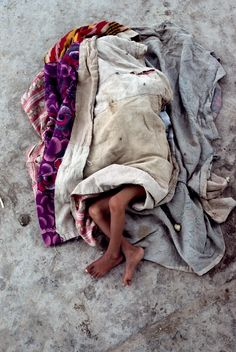 How do these precious ones survive even one day or one night. Prayers for this child. Sleep | Steve McCurry