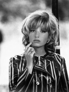 Monica Vitti (born 3 November 1931) is an Italian actress best known for her starring roles in films directed by Michelangelo Antonioni during the early 1960s. After working with Antonioni, Vitti changed focus and began making comedies, working with director Mario Monicelli on many films. She has appeared opposite Marcello Mastroianni, Richard Harris, and Dirk Bogarde.