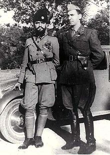 two men in uniform leaning against a car Ukraine, Military Careers, Political Beliefs, Cultural Significance, National History, War Image, Roman History, Men In Uniform, Japan