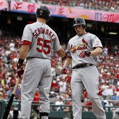 St. Louis Cardinals' David Freese celebrates with Skip Schumaker (55) after Freese's two-run homer during the second inning of a baseball game against the Washington Nationals at Nationals Park Saturday, Sept. 1, 2012, in Washington. (AP Photo/Alex Brandon)