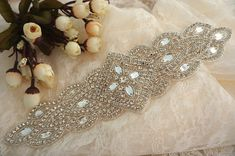 Gorgeous wedding / bridal applique with high quality, genuine crystal rhinestones, crystals, beads, rhinestones and beads are all hand sewn .