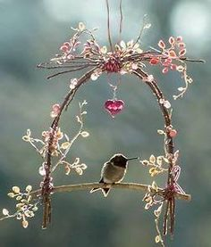 Lovely little bird perch!  I could use sticks (willow banches), dried pink Fairy Cushion roses & glass beads!