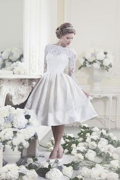 1950s-style tealength lace wedding dress with long sleeves