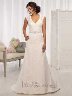 For the bride looking for elegant wedding dresses, this gorgeous Lace over Dolce Satin A Line cap sleeve wedding dress proves to be the perfect choice. It features a figure-flattering V neckline, a delicate Lace illusion back and a 1.5