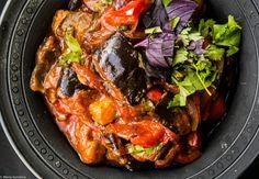 Аджапсандали.      Баклажаны — 4 шт. (общим весом около 1,2 кг).     Перцы сладкие — 4 шт. (общим весом около 600 г).     Лук (лучше красный) — 2 шт.     Помидоры консервированные резаные или томатное пюре — 400 г.     Кумин (зира) — 2 ч. л.     Кориандр — 2 ч. л.     Паприка — 2 ст. л.     Чеснок — 2 зубчика.     Кинза — 1 пучок.     Базилик красный — 1 пучок.     Масло растительное, уксус винный.     Перец чёрный молотый, чили молотый, соль, сахар.