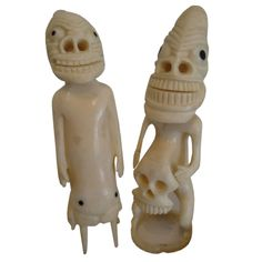 carved Ivory Tupilak figures with extruded anthropomorphic features and inset baleen eyes. These were carved as souvenirs by the Inuit people of Greenland.