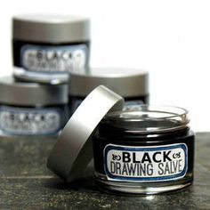 Black Drawing Salve Recipe 1.5 oz. olive oil infused with plantain leaves, calendula flowers & comfrey leaves 1 oz. activated charcoal .5 oz. raw beeswax .5 oz. bentonite clay .5 oz. sourwood honey .25 oz. 76°F melt point coconut oil .25 oz. shea butter .25 oz. green tea powder 2 ml vitamin E 1 ml rosemary extract 1 ml tea tree oil 1 ml fir needle essential oil 1 ml lavender essential oil