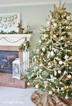 Coastal Christmas Tree  and mantle- gold silver, aqua, and love the rope on the mantle