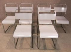 Industrial stacking chairs. These superb and extremely sturdy retro stacking tubular steel chairs are fitted with curved seats and back supports...