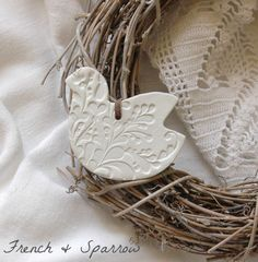 Handmade clay dove ornament or gift tag, embossed with flourish design