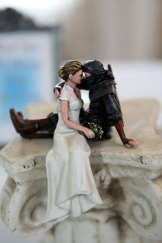 Which also made an appearance as their cake topper. | This Couple Just Had The Ultimate Geek Wedding