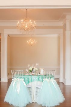 Sequined emerald tablecloth and mint-green tulle chair swag   Photo by Casey Hendrickson