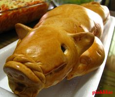 lechon (roasted pig) bread thinking about making this for christmas and fill with gratin potatoes  with ham or sausage.