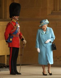 What did he say? The Queen has a fit of giggles as she walks past Philip, in full Guards u...