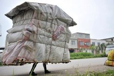 """Liu Lingchao, a Chinese man from Guangxi who has spent the past 5 years walking across the country on a journey back to his hometown carrying a portable """"house"""" (makeshift shelter) on his shoulders, collecting recyclable garbage to make a living. Crazy Houses, Little Houses, Weird Houses, Bauhaus, Art Populaire, Portable House, Unusual Homes, Mobile Home, Weird And Wonderful"""