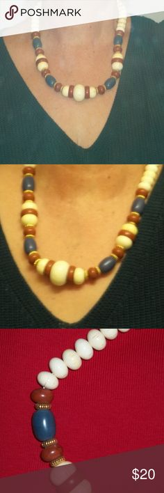 Vintage Necklace Beads and gold tone ring spacers.  Beads are cream, 4 are blue, and 12 are rust color. Necklace might be anywhere from 70s to early 90s. Beads are in mint condition. Jewelry Necklaces