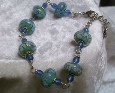 """$40.00 Blue and Green Lampwork & Sea Glass Silver Wire Wrapped Bracelet 7"""" - 8"""" #Handmade #Lampwork This blue and green together reminds me of hydrangeas!"""