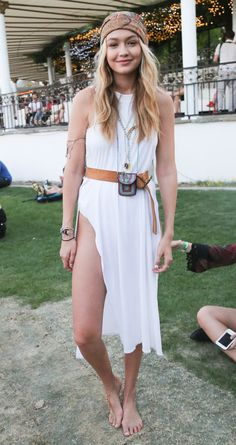 Gigi Hadid wore this boho white dress with a leather belt and a turban.